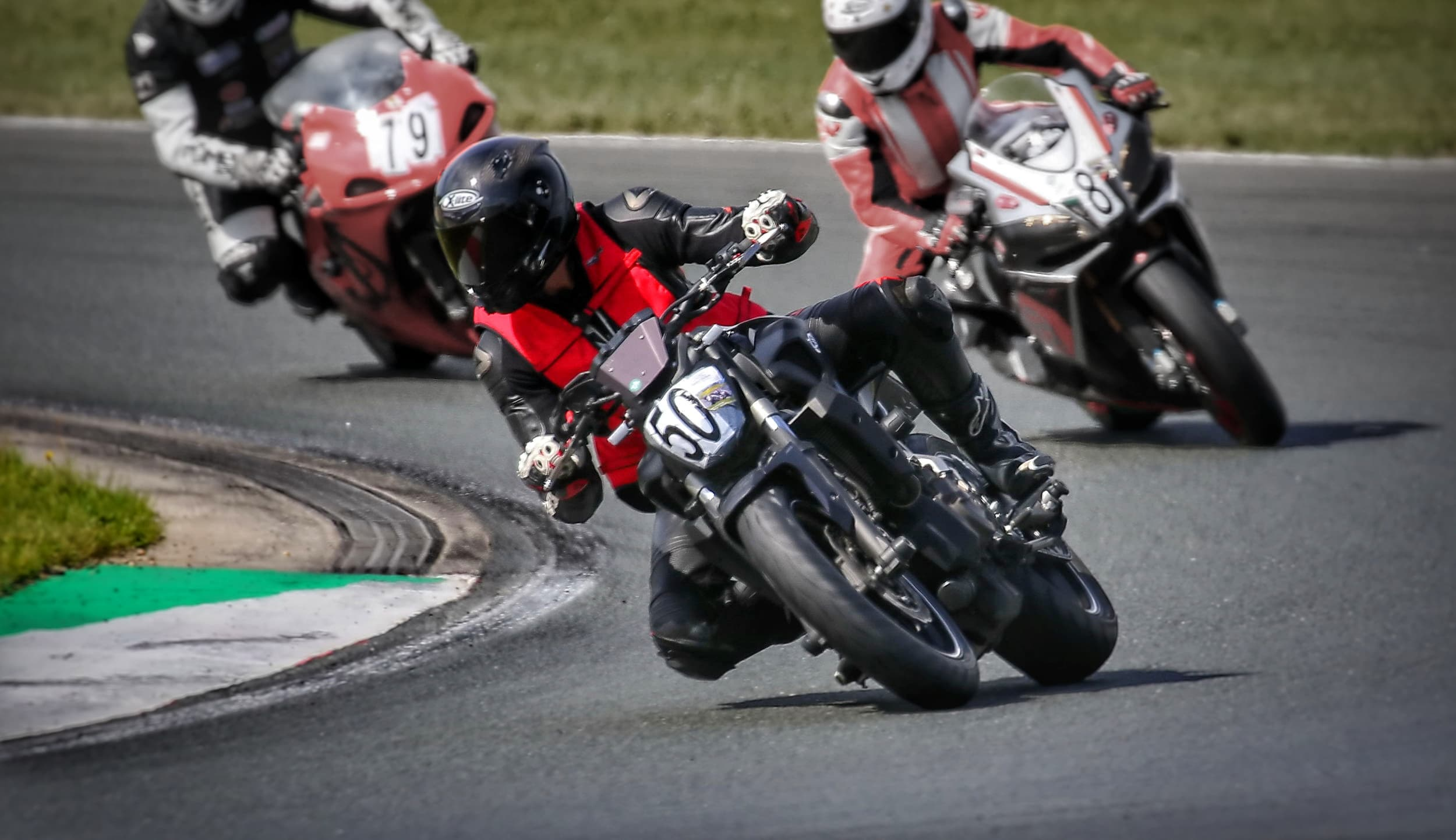 A picture of Alexander Oliver Mader riding his motorcycle (a Yamaha MT 07) at the racetrack Motorsport Arena in Oschersleben, Germany.